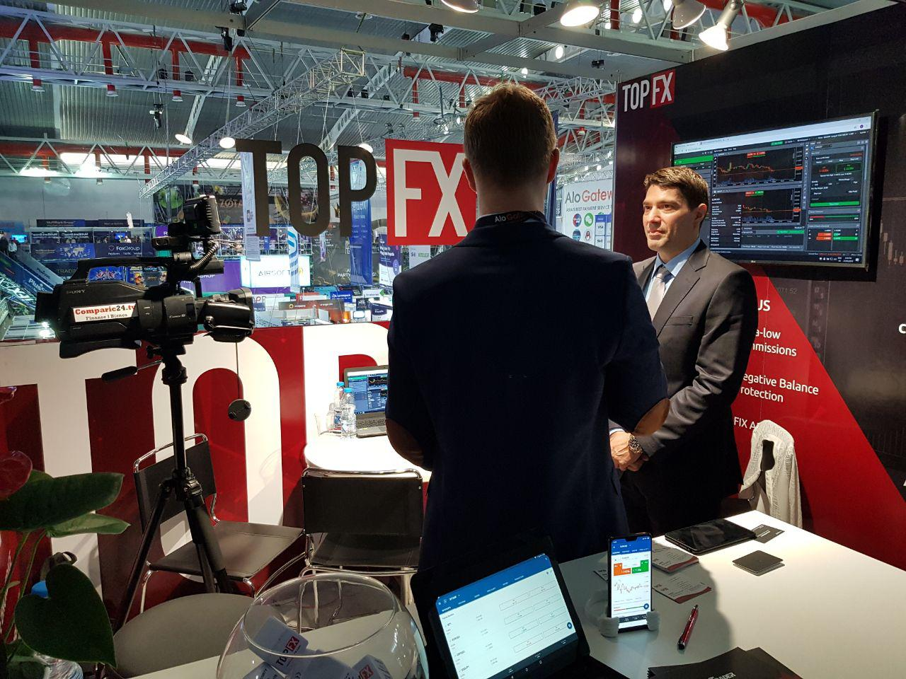 TopFX CEO Alex Katsaros being interviewed by Comparic Media Group at the iFX Expo